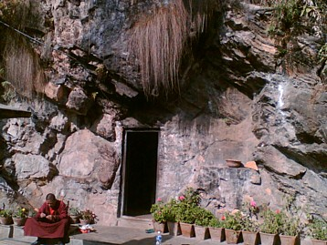 Entrance to Asura Cave with Tibetan Buddhist Monk.