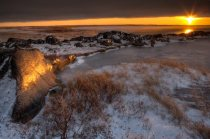 Sunset over the rocky coastline of Hudson Bay, Churchill, Manitoba, Canada.